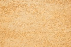 Background of textured plaster of golden color Product Image 1