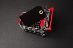 Shopping cart on the black background. Shopping card with a Product Image 1
