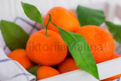 Bright tangerines in a white small box on a white background Product Image 3