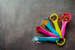 Multicolored measuring spoons with spices. Copy space Product Image 1
