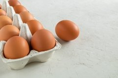Close-up of chicken eggs in an egg carton. Product Image 1