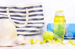 healthy snack, measuring tape and water bottle on a light wo Product Image 1