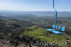 Blue cable car high in the mountaines Product Image 1