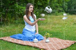 Surreal design. Girl sitting on the grass while drinking tea Product Image 1