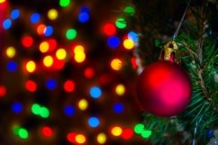 Red Christmas ball on Christmas tree with blurred lights. Product Image 1