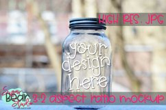 Mason Jar in Snow Mockup Product Image 1