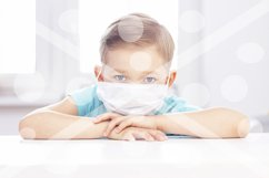 concept of coronavirus infection. A boy in a medical mask is Product Image 1