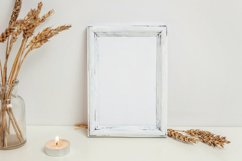 Vertical frame mockup with rye bouquet in vase, white wall Product Image 1