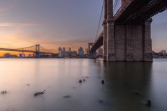 Brooklyn and Manhattan Bridges at sunrise from East River Product Image 1
