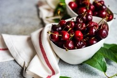 Ripe and organic sweet cherry berries in a box Product Image 1