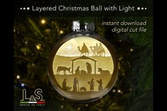 Layered Christmas bauble with nativity
