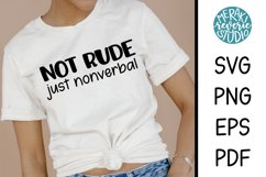 Woman wearing a shirt for nonverbal autism awareness.