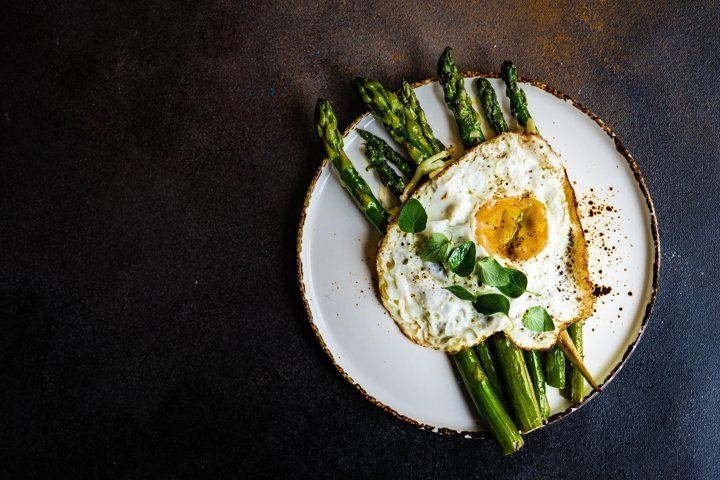 Organic grilled asparagus served for healthy keto lunch