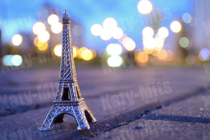 Eiffel tower figure on a background of evening bokeh lights