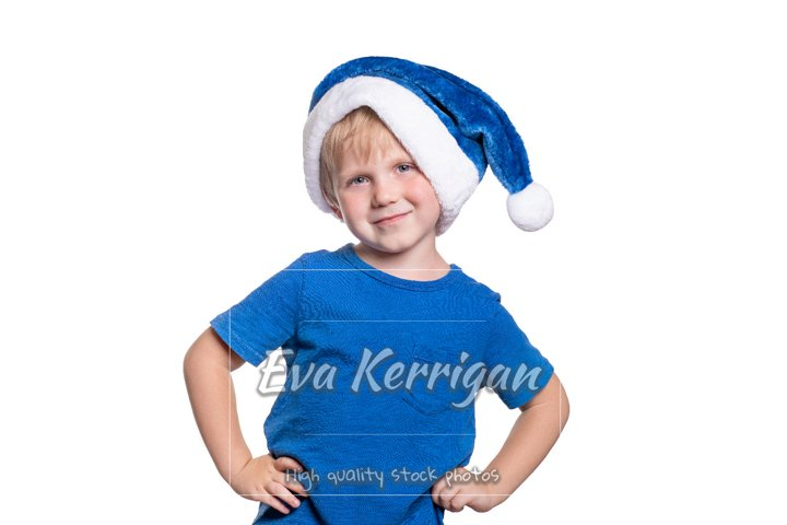A child boy of European appearance in blue santa claus hat.