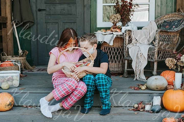 children a boy and a girl in pajamas and face mask