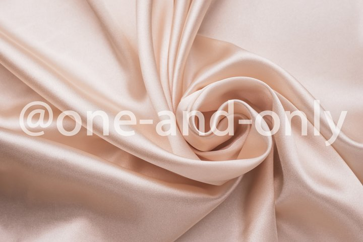 Smooth elegant wrinkled silk fabric background.