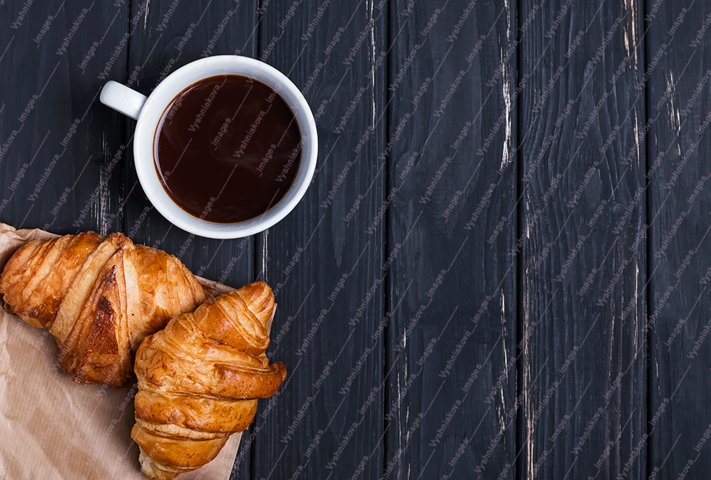 Coffee and croissants on the black table