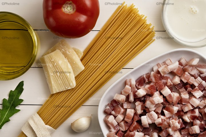 Cooking ingredients on white wooden rustic background. Pasta