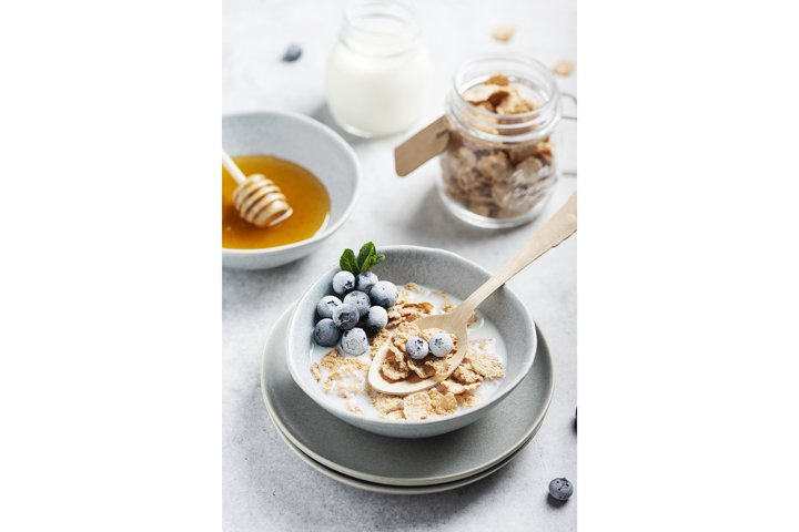 Healthy breakfast with corn flakes and milk, selective focus