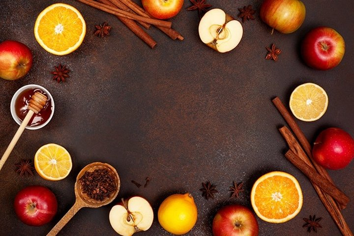 fruits and spices on brown background