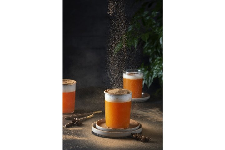 Winter ornage drink with milk, cinnamon and pumking