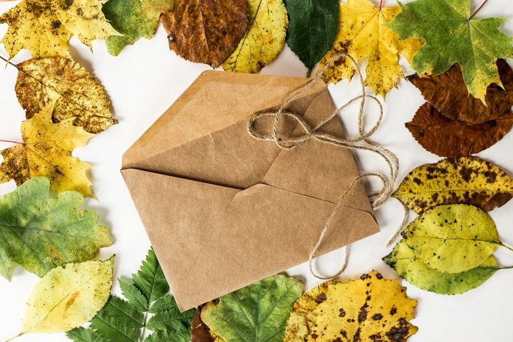 craft envelope in autumn leaves on the table