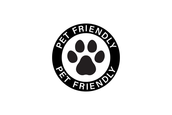 Pet paw or dog label. Footprint with pet friendly text.