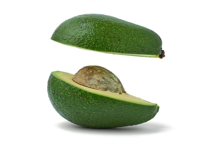 cut ripe green avocado