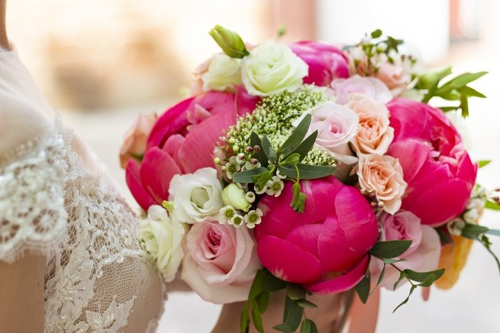 Bridal bouquet of bright red peonies and roses