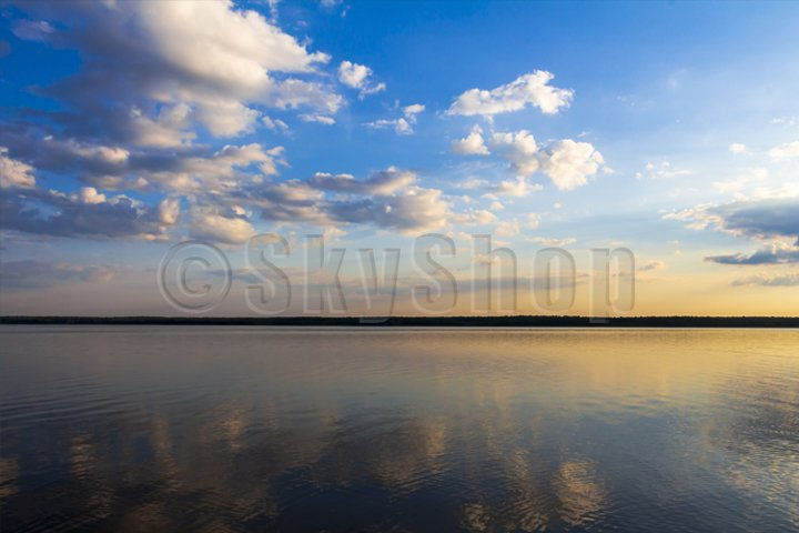 clouds reflected in the mirror of the lake