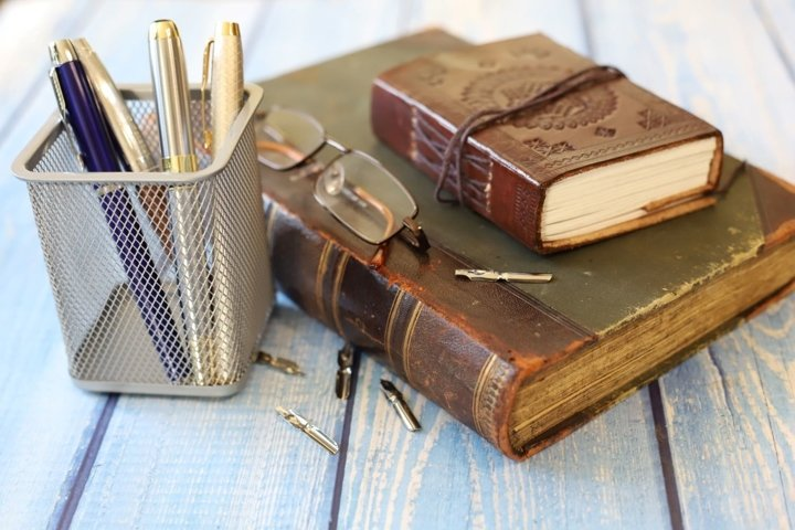 antique book and leather notebook