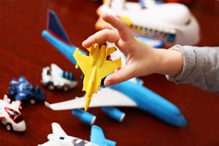 Child with toy planes.