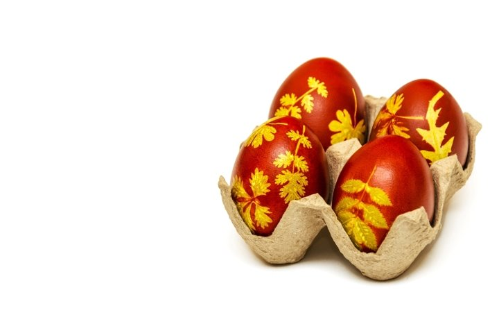 Easter eggs dyed with onion husks with pattern of leaves
