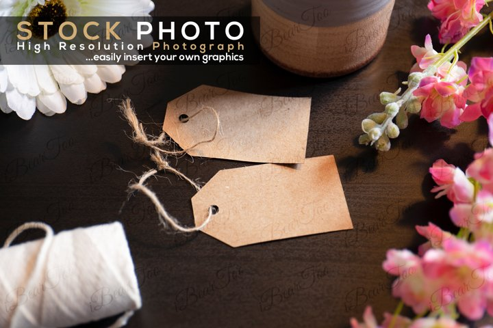 Tags Label Stock Photo on Dark Wood Table and Flowers