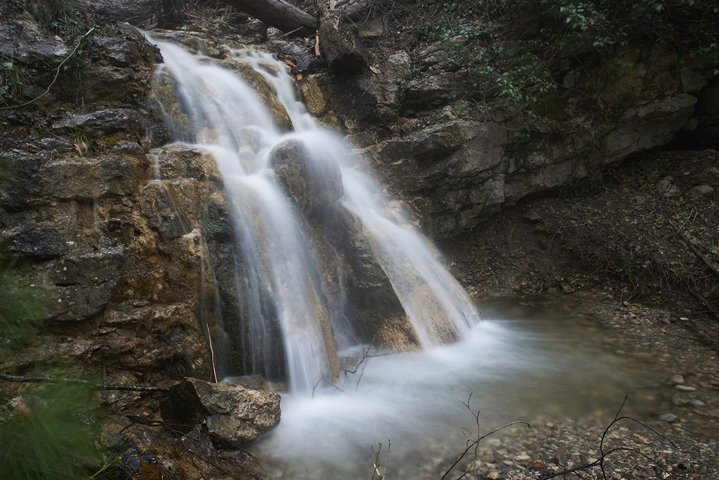 Beautiful waterfall in the forest. Water motion.