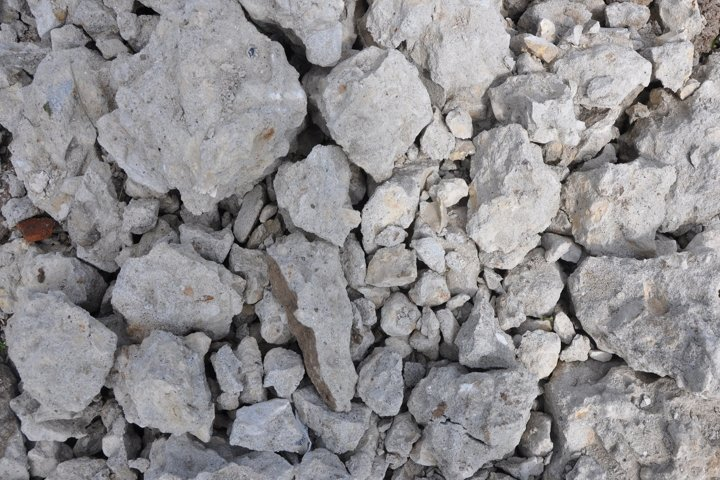 Gray stones background or texture. Cobblestone. Close up.