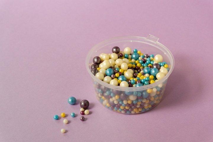 Multicolored sweet sprinkles in bowl