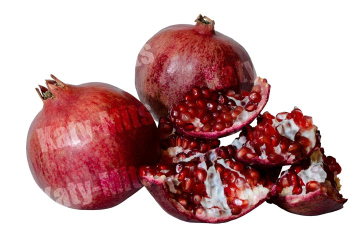 2 pomegranates with grains isolated on white background