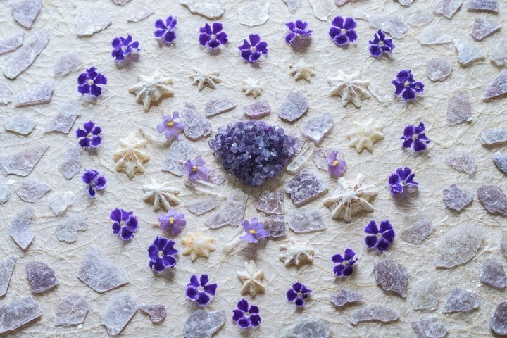 Heart Art. Shells, crystals and tiny purple flowers