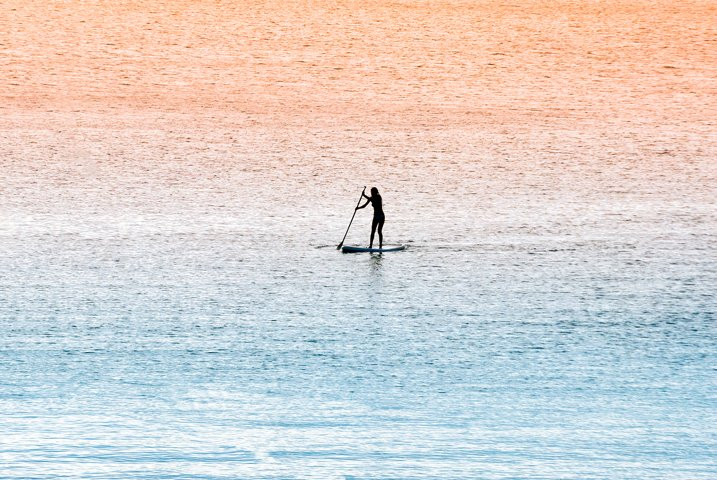 Standup paddle surfer girl
