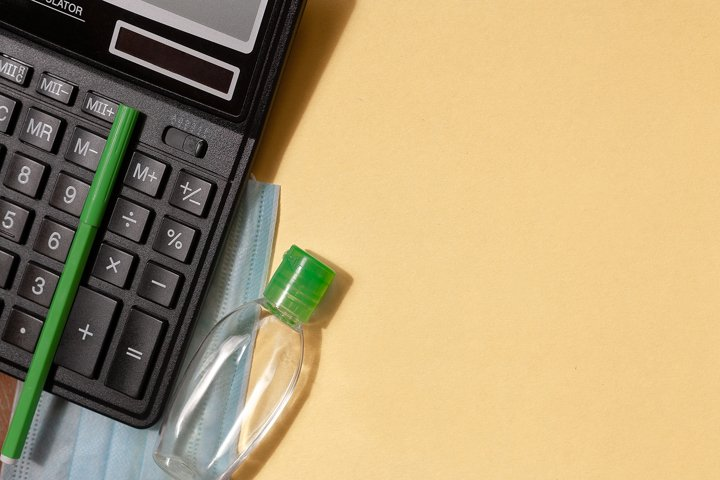 Calculator, sanitizer, green marker