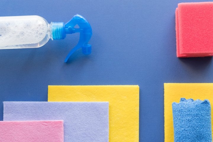 cleaning supplies on blue background