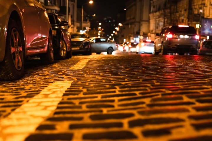 Paving stones on roadway with glare from night illumination