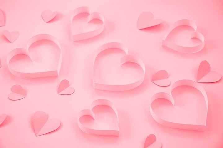 Heart on a pastel pink background. Valentines Day.