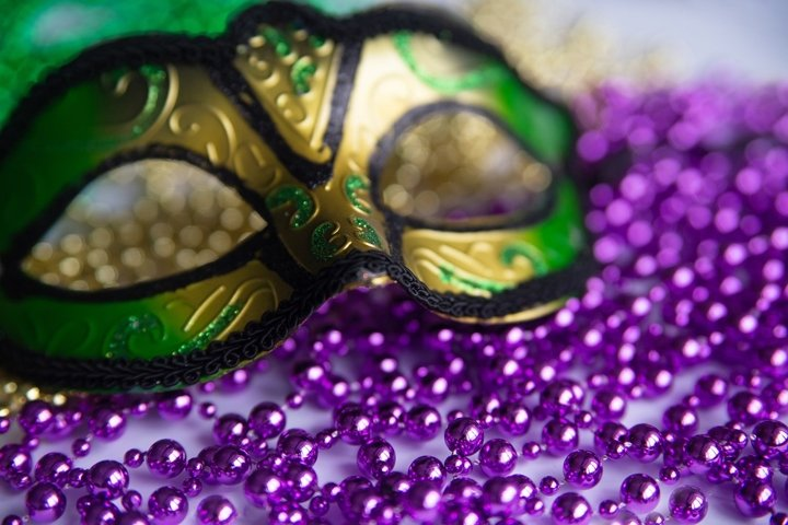 Mardi gras background. Mask and beads closeup