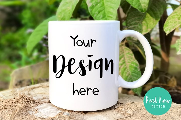 White Coffee Mug Mockup with Green Leaves