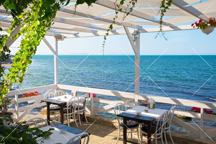 Cafe on sea coast with chairs and tables in Bulgaria
