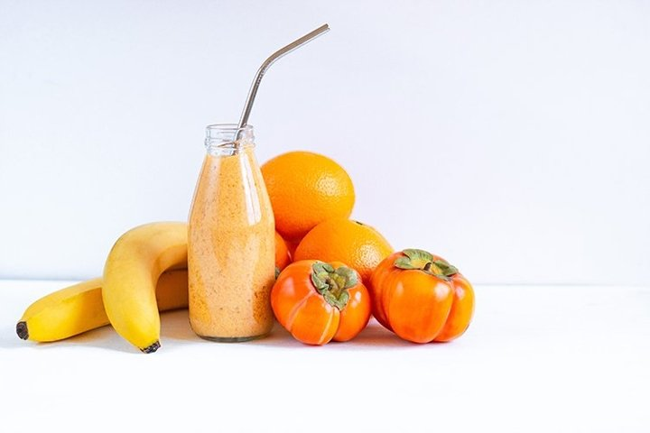 Fruit smoothie made with persimmon, banana and orange.