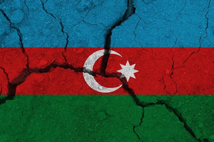 Azerbaijan flag on the cracked earth.